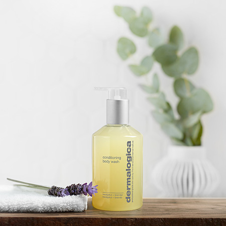 Image of the Condition Body Wash with lavender and a towel